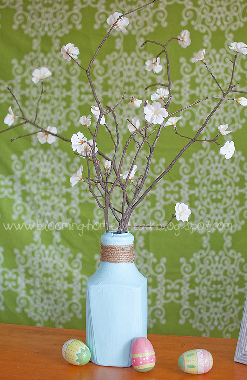 Easy spring centerpiece using an uncycled orange juice bottle! So pretty!