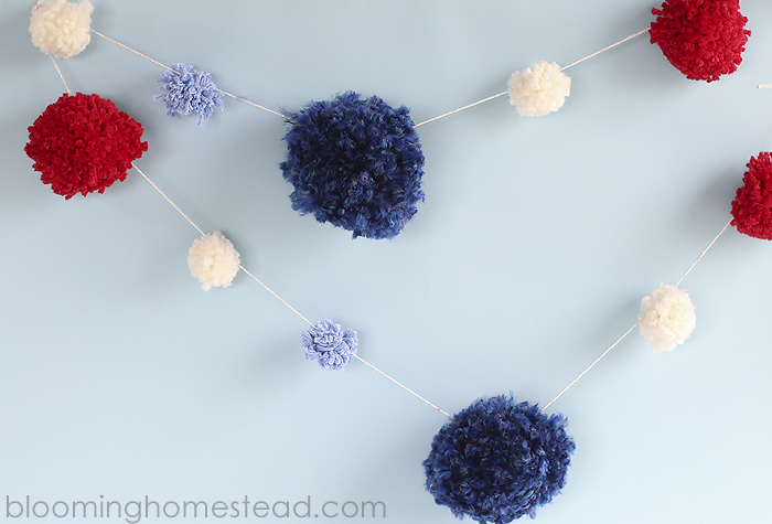 DIY Pom Pom Garland for 4th of July Decor. These are so cute and so easy to make!