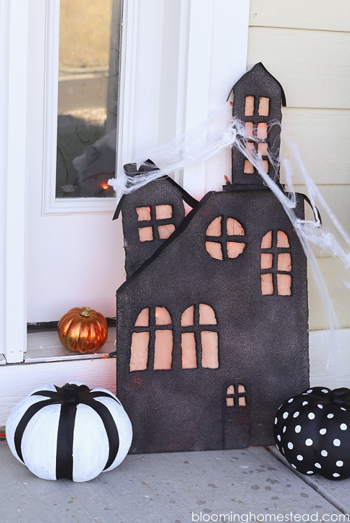 This diy lighted haunted house is so simple and easy to make, be sure to check out the full tutorial on www.bloominghomestead.com