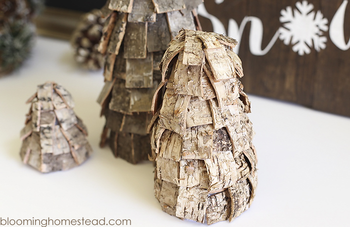 Beautiful DIY Rustic Christmas trees using birch bark. These are so easy and affordable to make and they look great too. Perfect for the holidays, winter, and would even be lovely all year long.