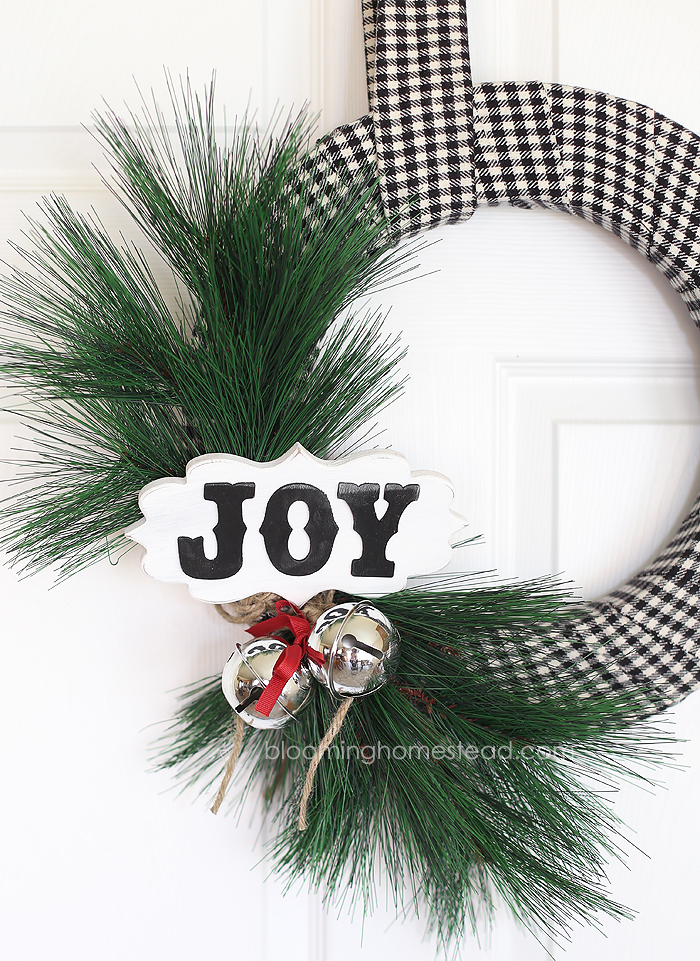 This diy Christmas Wreath is so pretty and is so easy to make. You can watch the video tutorial to learn how to make your own for the holidays!