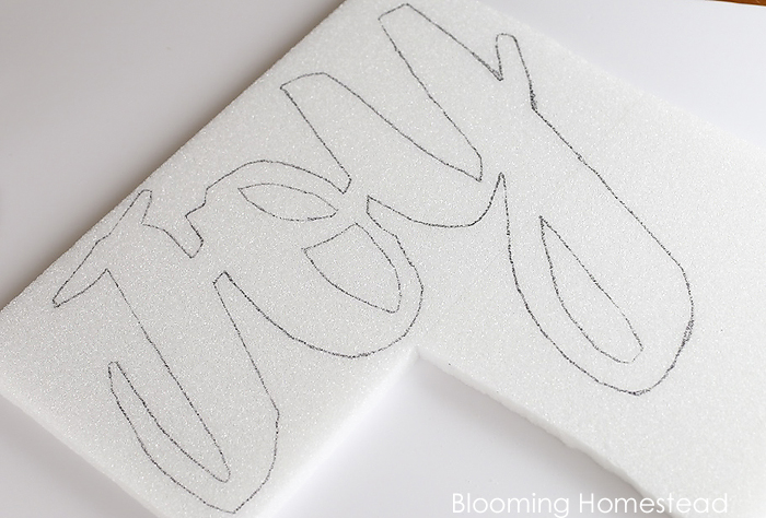 Easy to make diy glitter JOY sign using foam! Check out the full tutorial at Blooming homestead