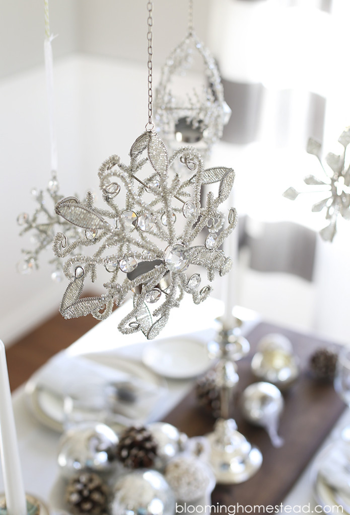 Beautiful winter decor for holiday entertaining. Love these hanging snowflakes!