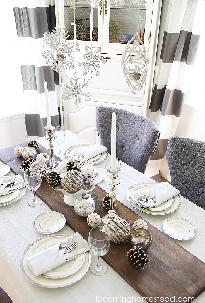 Beautiful winter tablescape featuring a metallic feel with rustic elements.  Wouldn't this be
