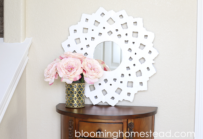 DIY Sunburst mirror made using foam! Such a fun and easy idea.