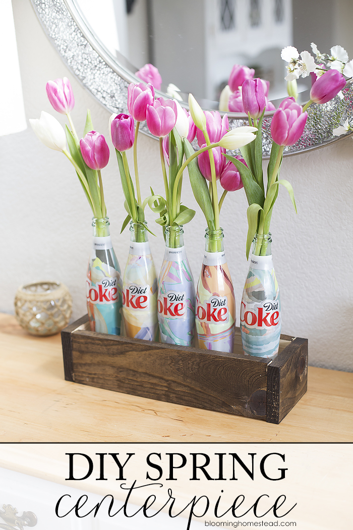 Easy Spring Centerpiece using upcycled Coca-Cola Bottles. Super cute!