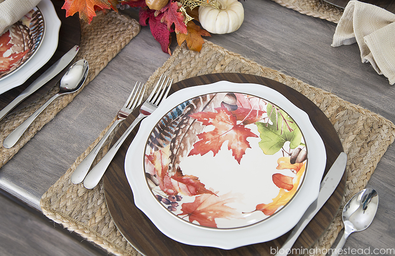 Beautiful Fall Tablescape with festive place settings and lovely fall centerpiece