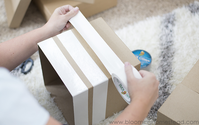 wrapping-tape-around-boxes